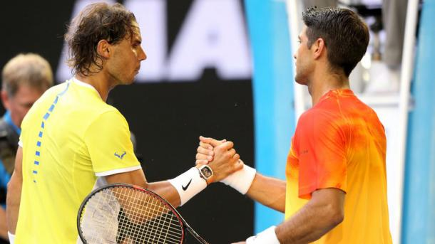 Nadal shakes hands with Verdasco after their first round encounter / Michael Dodge, Getty Images