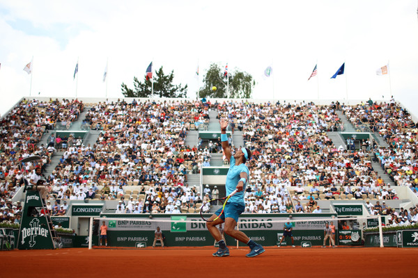 Nadal serves in front of the Suzanne Lenglen crowd (Getty/Cameron Spencer)