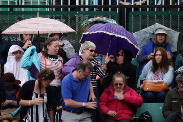 Rain not only delayed start of play for the day but also interrupted the doubles final at a crucial time. Photo: Getty