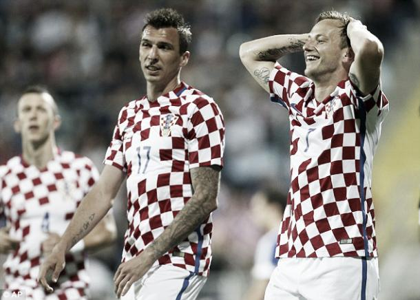 Above: Mario Mandzukic and Ivan Rakitic reacting to a rare miss in Croatia's 10-0 win over San Marino | Photo: AP