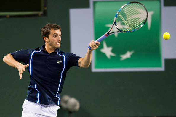 Albert Ramos-Vinolas returns a shot on Monday. Photo; Robyn Beck/Getty Images/AFP