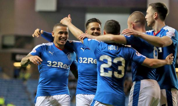 Rangers players celebrate winning the title. Source: The Guardian.