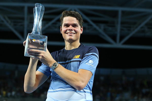 Raonic hoists his Brisbane trophy in January. Photo: Chris Hyde/Getty Images