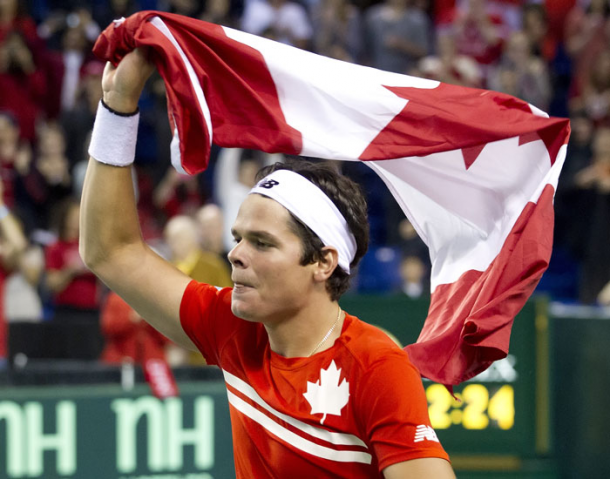 Milos Raonic waves the flag after Canada defeated Italy in the 2013 Davis Cup Quarterfinals. Photo: Davis Cup