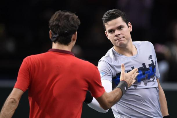 Raonic (right) shakes hands after beating Roger Federer (left) in 2014. Photo: Frank Fife/AFP