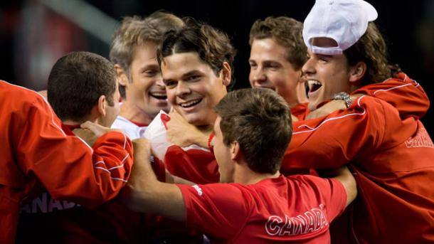 Milos Raonic is embraced by his team after their upset of Spain in 2013. Photo: Darryl Dyck/Canadian Press