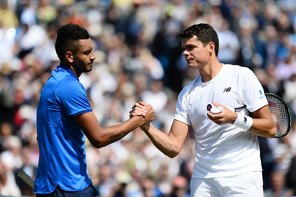 Raonic (right) and Kyrgios shake hands after Raonic's victory. Photo: Patrik Lundin/Getty Images