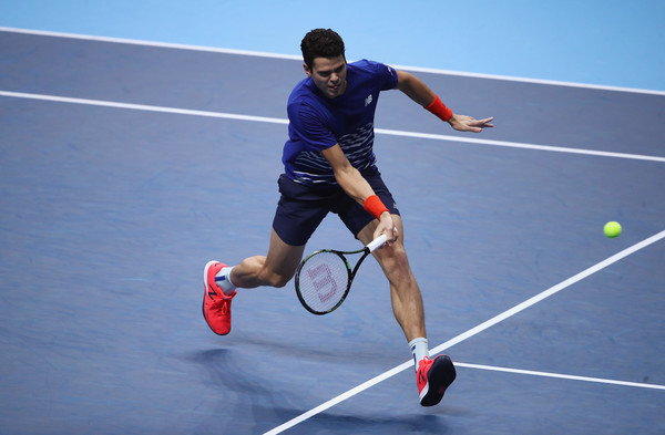 Milos Raonic hits a low forehand volley during his win on Thursday. Photo: Julian Finney/Getty Images