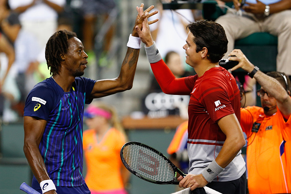 Monfils (left) and Raonic put on a great display of sportsmanship after the match. Photo: Julian Finney/Getty Images
