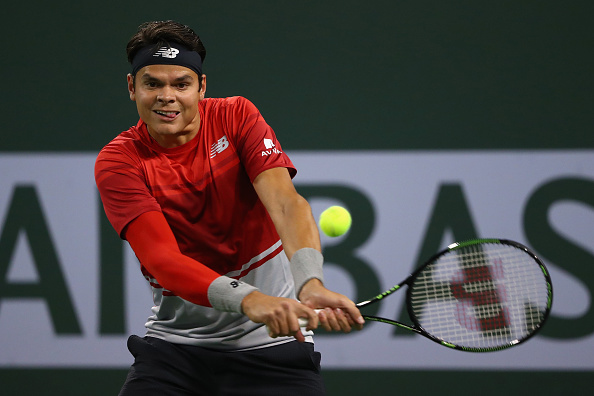 Milos Raonic hits a backhand during his quarterfinal win. Photo: Julian Finney/Getty Images