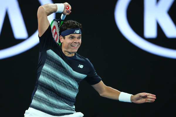 Milos Raonic follows through on a forehand during his quarterfinal loss. Photo: Clive Brunskill/Getty Images