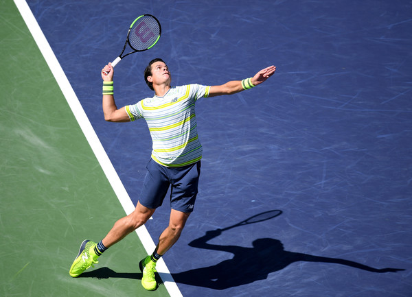 Raonic fires one of his clutch serves during the quarterfinal win. The Canadian's big serve bailed him out in the final set. Photo: Harry How/Getty Images