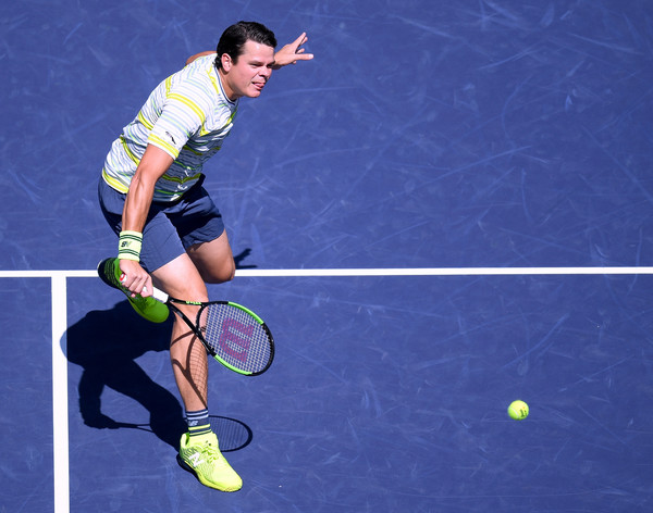 Milos Raonic volleys during one of his 34 net attacks during the quartefinal win. Photo: Harry How/Getty Images
