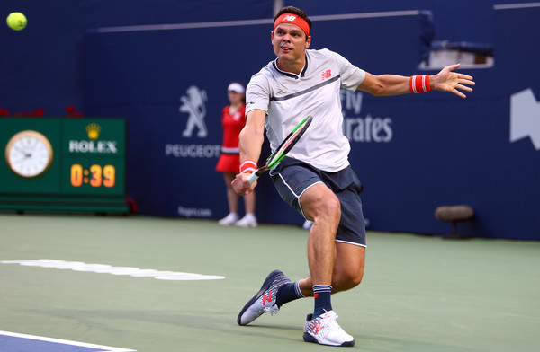 Milos Raonic slides into a backhand on Centre Court in Toronto. Photo: Getty Images
