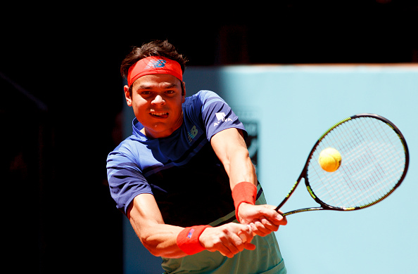 Milos Raonic hits a backhand during his first round match. Photo: Guillermo Martinez/Getty Images