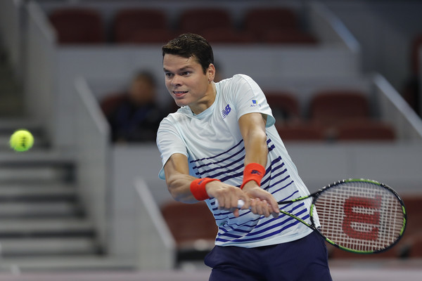 Milos Raonic hits a backhand. Photo: Lintao Zhang/Getty Images