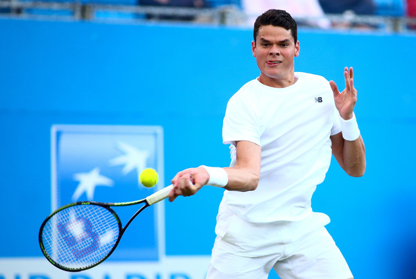 Raonic crushes a forehand during the first day of the match. Photo: Jordan Mansfield/Getty Images