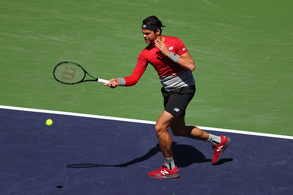 Raonic hits a forehand to Cervantes during his win. Photo: Julian Finney/Getty Images