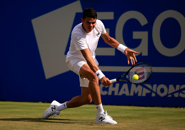 Milos Raonic slices a backhand during an early round match at the Queen's Club. Photo: Getty Images