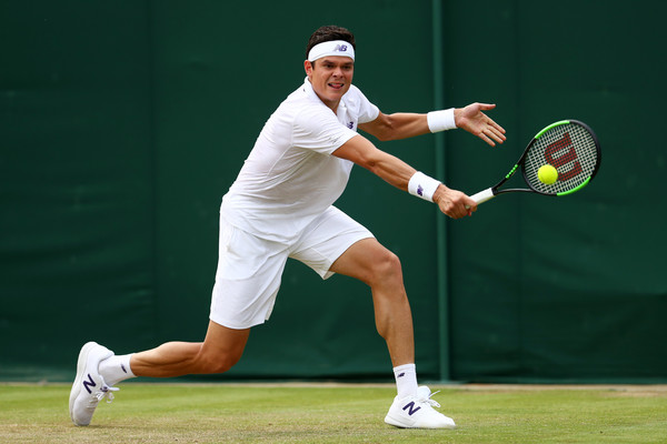 Raonic hits a backhand on Thursday at Wimbledon. Photo: Michael Steele/Getty Images