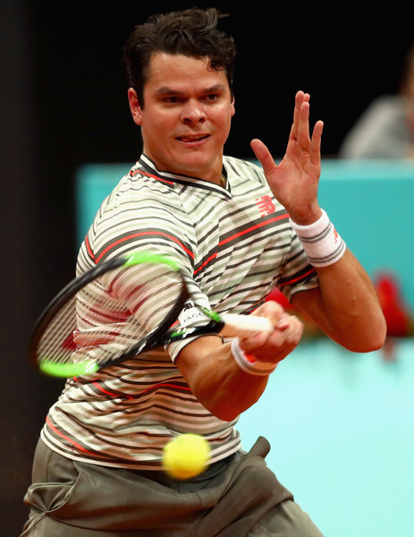 Raonic crushes a forehand during his victory on Tuesday in Madrid. Photo: Clive Brunskill/Getty Images