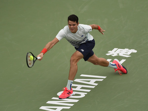 Milos Raonic lunges for a backhand during his second round match. Photo: Kevin Lee/Getty Images