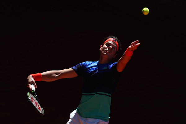 Raonic tosses up one of his big serves. Photo: Julian Finney/Getty Images