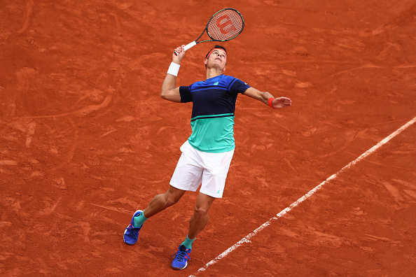 Raonic tees up one of his giant serves. Photo: Julian Finney/Getty Images