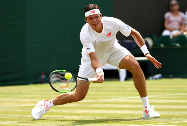 Milos Raonic gets low for a volley, one of his almost 50 net approaches in the match. Photo: Matthew Stockman/Getty Images