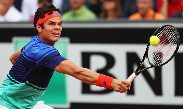 Raonic stretches for a backhand. Photo: Matthew Lewis/Getty Images