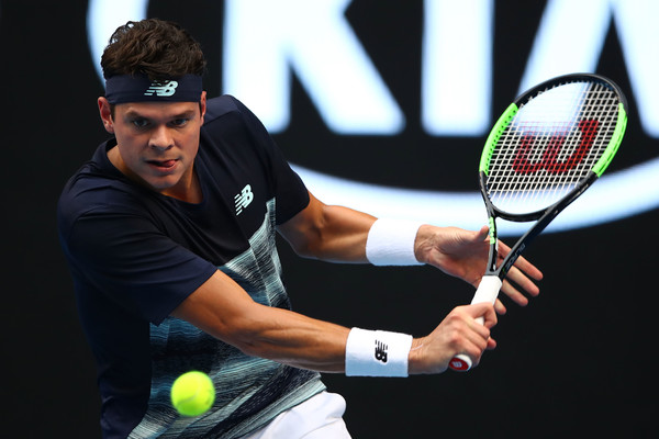 Raonic slices a backhand during his fourth round win. Photo: Clive Brunskill/Getty Images