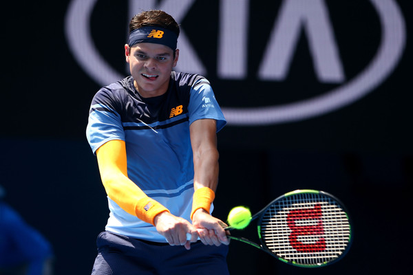 Raonic hits a backhand in his fourth round match. (Photo: Mark Kolbe/Getty Images)