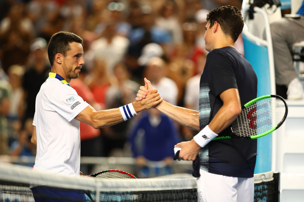 Raonic (right) and Bautista Agut shake hands after the Canadian's victory. Photo: Clive Brunskill/Getty Images