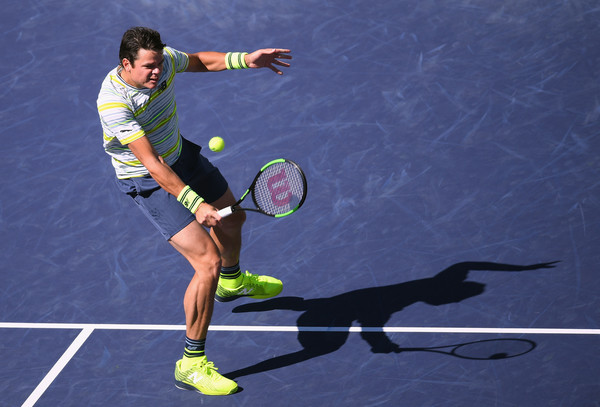 Milos Raonic hits a volley during the Indian Wells semifinal, where he struggled to keep the ball in play. Photo: Harry How/Getty Images