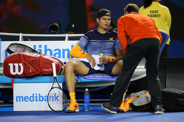 Milos Raonic speaks to the trainer during the fourth set of his semifinal. Photo: Michael Dodge/Getty Images