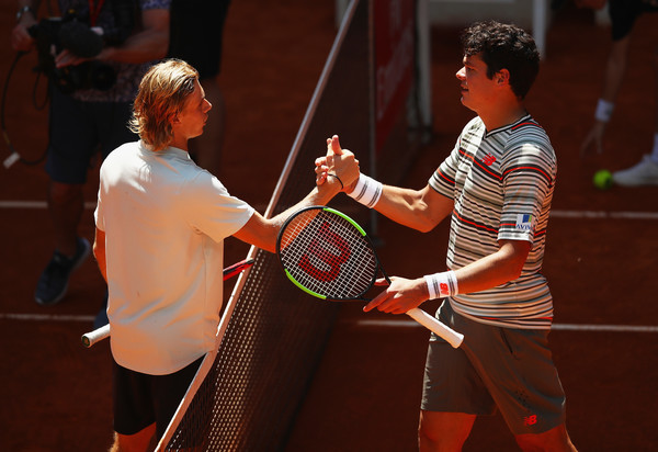 Shapovalov (right) and Raonic shake hands after the first meeting between Canadian tennis' future and present. Photo: Clive Brunskill/Getty Images