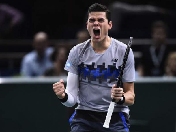 Raonic celebrates his upset of Roger Federer at the 2014 Paris Masters. Photo: Franck Fife/AFP/Getty Images