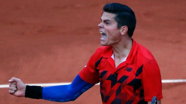 Raonic roars after winning an epic third round match at the 2014 French Open, his most recent appearance. Photo: Michel Euler/AP