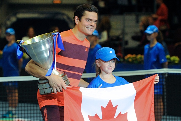 Raonic poses with the trophy and flag after his title in St. Petersburg last September. Photo: Olgo Maltseva/AFP/Getty Images