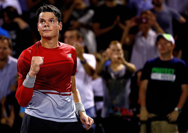 Raonic celebrates his fourth round win in Miami. Photo: Mike Ehrmann/Getty Images