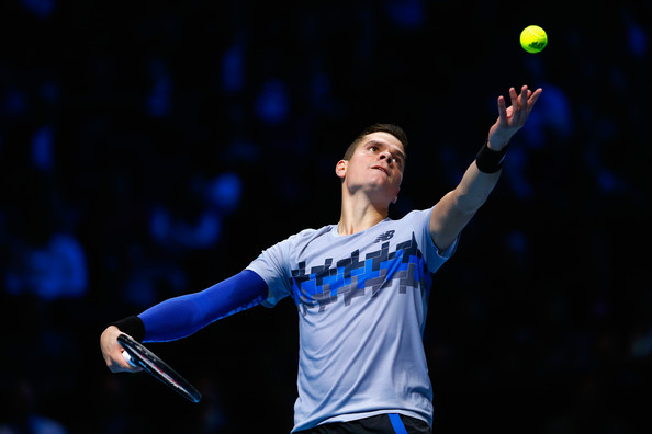 Raonic tosses up a serve during a round robin match at the 2014 tour finals. Photo: Julian Finney/Getty Images