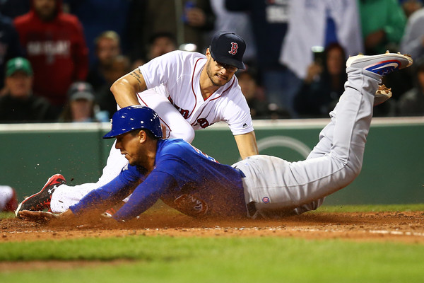 Jon Jay slides into the plate in the seventh inning. (Adam Glanzman/Getty Images North America)