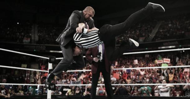 Triple H performing a pedigree to a referee (image: therichest.com)
