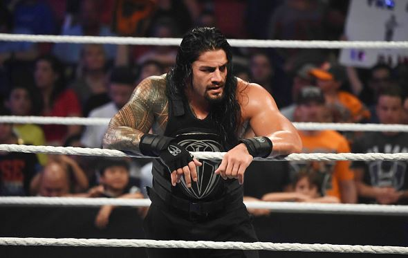Roman Reigns looks on during the WWE Smackdown on September 1, 2015 at the American Airlines Arena in Miami, Florida. (Photo by Ron ElkmanSports Imagery/Getty Images