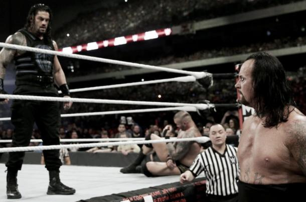 Reigns stands tall above The Undertaker, will this image be the same come WrestleMania? (image: dailyddt.com)