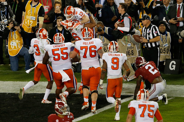 Renfrow (13) is mobbed by his teammates after scoring the touchdown that delivered Clemson their first title in 35 years/Photo: Brian Blanco/Getty Images