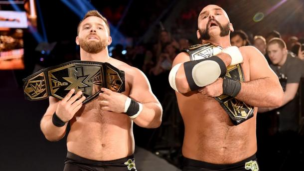 """""""No fists just flips,"""" the champs retain. Photo: WWE.com"""