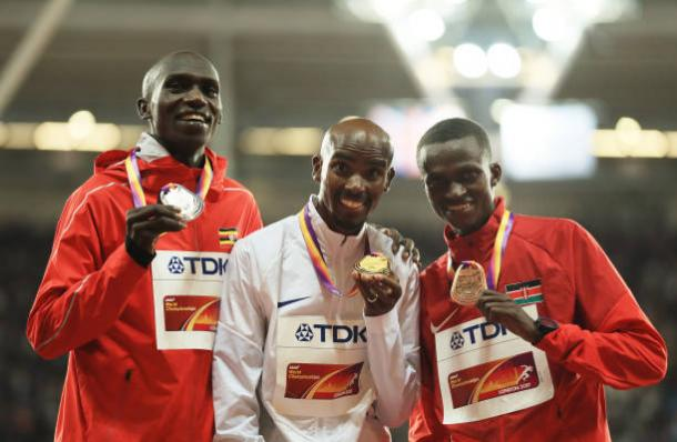 Cheptegei, Farah, and Tanui after receiving their medals (Getty/Richard Heathcote)