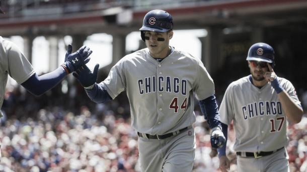 Chicago Cubs' Anthony Rizzo (44) celebrates as he runs back to the dugout following his second two-run home run off Cincinnati Reds starting pitcher Alfredo Simon in the third inning of a baseball game, Sunday, April 24, 2016, in Cincinnati. (AP Photo/John Minchillo)