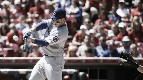 Anthony Rizzo hits a two run homer in the first inning of April 24ths game against the Reds (AP Photo/John Minchillo)